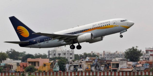 A Jet Airways passenger aircraft takes off from the airport in the western Indian city of Ahmedabad August...