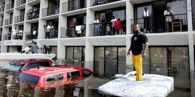 New Orleans Police and volunteers use boats to rescue residents from a flooded neighborhood on the east...