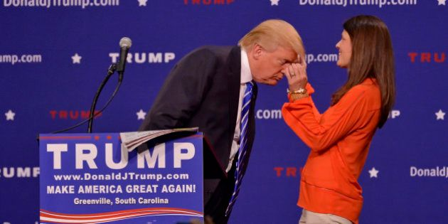Republican presidential candidate Donald Trump has a supporter, Mary Margaret Bannister, check to see...