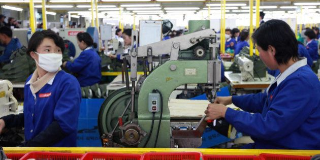 KAESONG, NORTH KOREA - DECEMBER 19: North Korean employees work at the assembly line of the factory of...