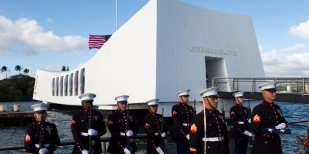 U.S. Marines stand at attention as the family of Pfc. Frank R. Cabiness arrives at a ceremony to have...