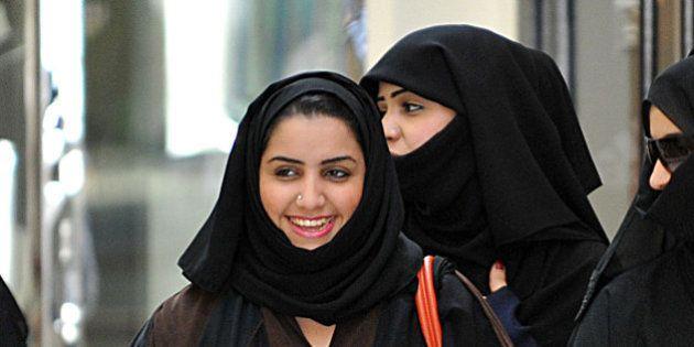 Saudi women walk inside the 'Faysalia' mall in Riyadh City, on September 26, 2011, a day after Saudi...