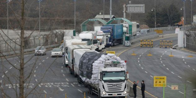 South Korean vehicles returning from North Korea's joint Kaesong Industrial Complex pass the customs,...