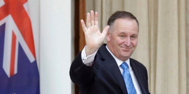 FILE - In this Oct. 26, 2016 file photo, New Zealand's Prime Minister John Key waves to media before...