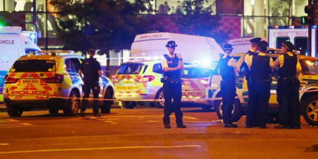 Police officers attend to the scene after a vehicle collided with pedestrians in the Finsbury Park neighborhood...