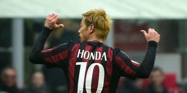 AC Milan's Japanese midfielder Keisuke Honda celebrates after scoring during the Italian Serie A football...