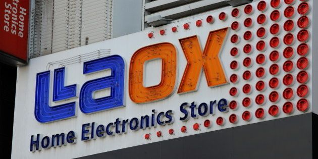 This picture shows the exterior signage of a Laox home electronics shop in Akihabara in Tokyo on May...