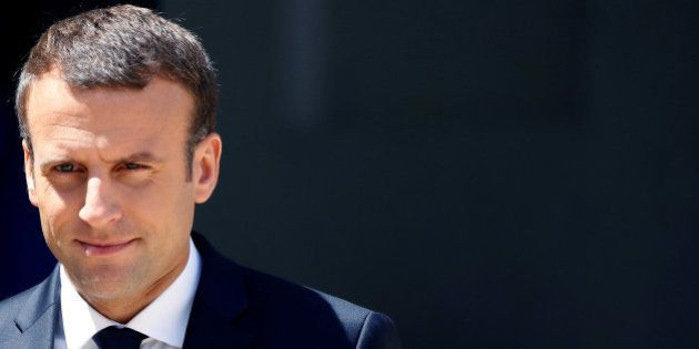 French President Emmanuel Macron stands on the steps of the Elysee Palace in Paris, France, June 16,...