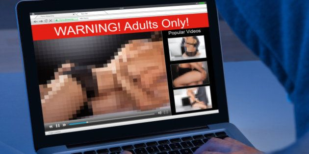 Close-up Of A Person Watching Adult Movie On
