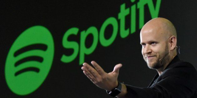 Daniel Ek, CEO of Swedish music streaming service Spotify, gestures as he makes a speech at a press conference...