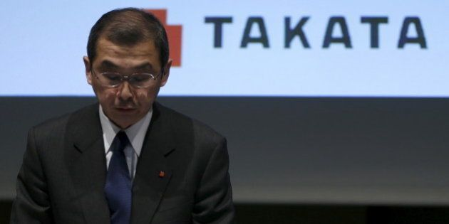 Takata Corp. Chief Executive and President Shigehisa Takada bows as he leaves a news conference in Tokyo...