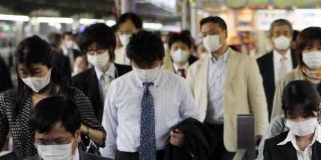 JAPAN - MAY 22: Commuters wear masks at the Osaka Station in Osaka City, Japan, on Friday, May 22, 2009....