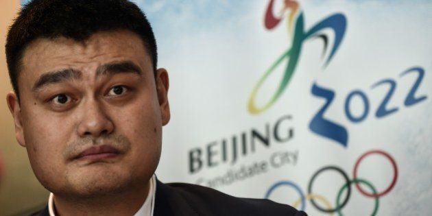 Retired Chinese professional basketball player Yao Ming looks on during a Beijing 2022 Olympics bid committee...