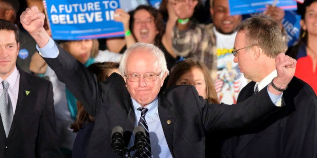 Democratic presidential candidate, Sen. Bernie Sanders, I-Vt., reacts to the cheering crowd at his primary...