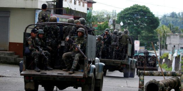 Truckloads of soldiers are pictured as they reinforce their comrades fighting the Maute group in Marawi...