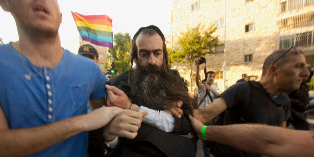 Ultra Orthodox Jew Yishai Schlissel is detained by plain-clothes police officers after he stabbed people...