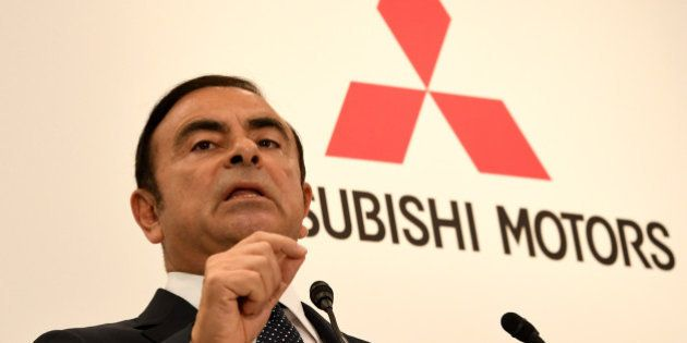 Nissan Motors chairman and CEO Carlos Ghosn answers a question during a joint press conference with Mitsubishi...
