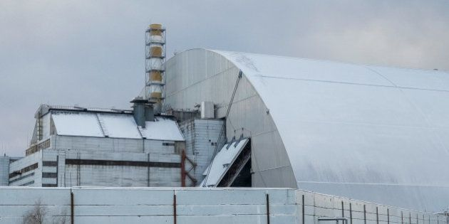 A general view shows a New Safe Confinement (NSC) structure over the old sarcophagus covering the damaged...