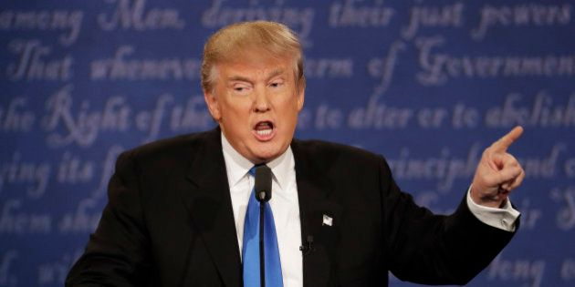 Republican presidential nominee Donald Trump speaks during the presidential debate with Democratic presidential...