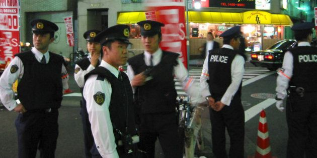 Japanese police patrol a street in down town Tokyo May 31, 2002 priorto the England - Sweden match in...