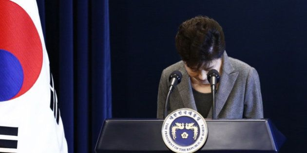South Korean President Park Geun-hye bows during her address to the nation at the presidential Blue House...