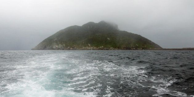 This September 30, 2016 picture shows a view of Okinoshima island, some 60 kilometres from Munakata city,...