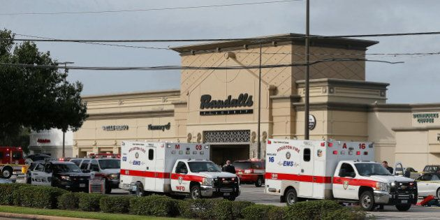 HOUSTON, TX - SEPTEMBER 26: Ambulance crews on standby after a gunman went on a shooting rampage wounding...
