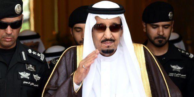 Saudi King Salman bin Abdulaziz (C) walks out to receive Sheikh Mohammed Bin Rashid al-Maktoum, ruler...