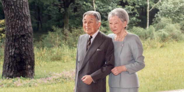 Japan's Emperor Akihito and Empress Michiko pose for a photograph at the Imperial Palace in Tokyo September...
