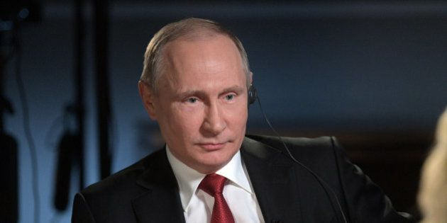 Russian President Vladimir Putin speaks with journalist Megyn Kelly during an interview on the sidelines...