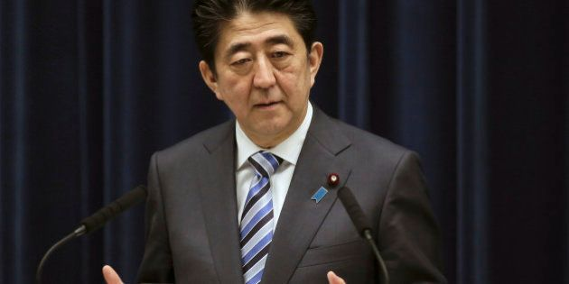 FILE - In this March 10, 2015 file photo Japanese Prime Minister Shinzo Abe speaks during a news conference...