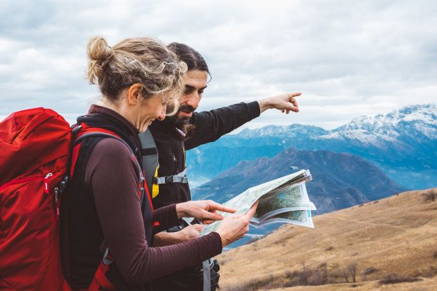 hiking couple with map in