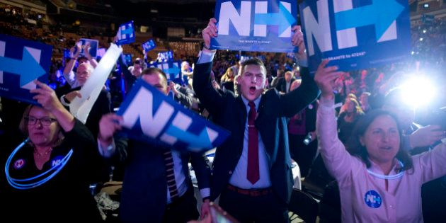 Supporters cheer as Democratic presidential candidate Hillary Clinton speaks at the New Hampshire Democratic...