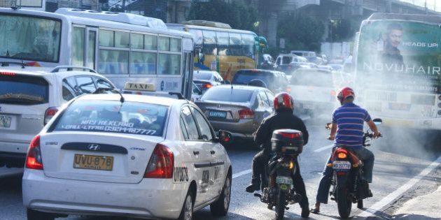 CUBAO, QUEZON CITY, PHILIPPINES - 2016/01/15: Motorcycle during heavy traffic near EDSA Highway. Philippines...