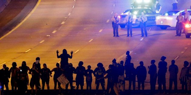 FILE - In this Thursday, Sept. 22, 2016 file photo, protesters block I-277 during a third night of unrest...