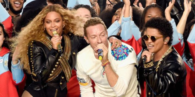 SANTA CLARA, CA - FEBRUARY 07: (L-R) Beyonce, Chris Martin of Coldplay and Bruno Mars perform onstage...