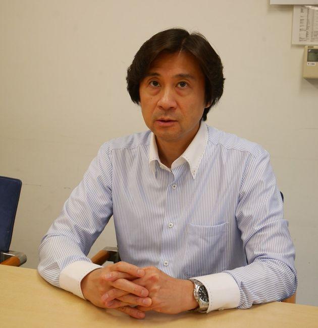 加熱式タバコの危険性について話す、都医師会タバコ対策委員会の委員長・村松弘康さん