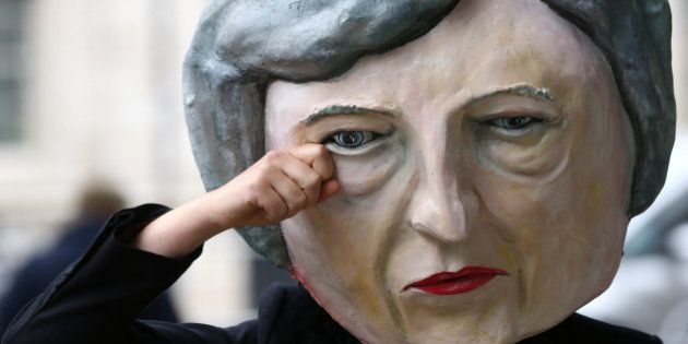 Protestor wearing a Theresa May mask poses outside Downing Street after Britain's election in London,...