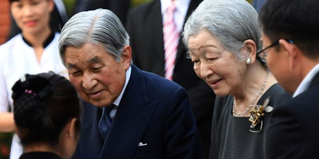 Japan's Emperor Akihito and Empress Michiko arrive at a meeting with Japanese volunteers from Japanese...