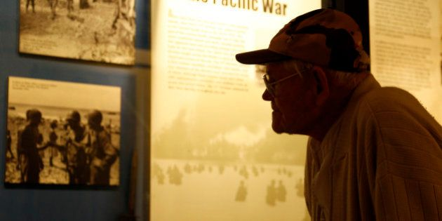 World War II veteran Arthur Robinson of Saratoga Springs, N.Y., looks at a display at the New York State...