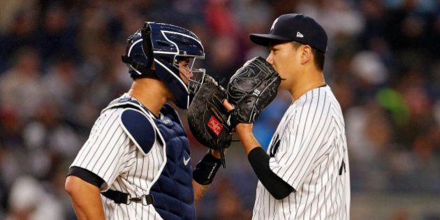 Jun 6, 2017; Bronx, NY, USA; New York Yankees starting pitcher Masahiro Tanaka (19) talks with Yankees...