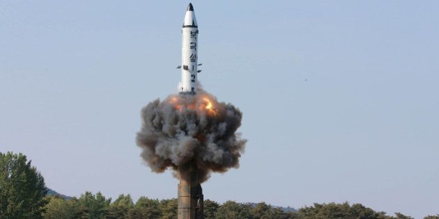The scene of the intermediate-range ballistic missile Pukguksong-2's launch test in this undated photo...