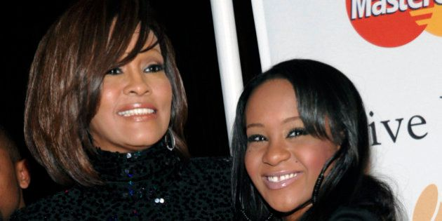 FILE - In this Feb. 12, 2011, file photo, singer Whitney Houston, left, and daughter Bobbi Kristina Brown...