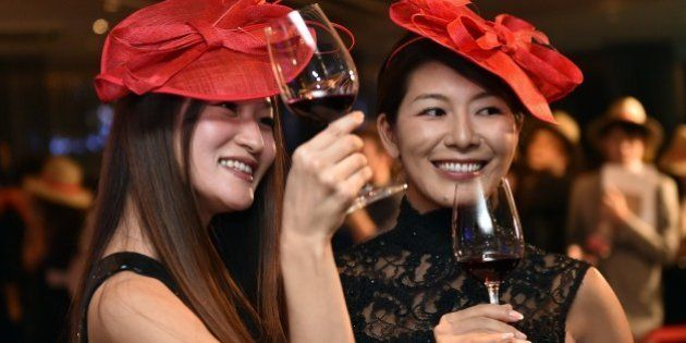 Japanese wine drinkers toast the 2014 vintage Beaujolais Nouveau wine at an event in Tokyo on November...