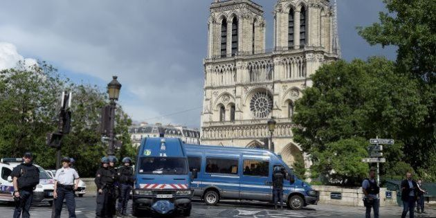 French police officials gather at the entrance to Notre-Dame cathedral in Paris on June 6, 2017. A French...