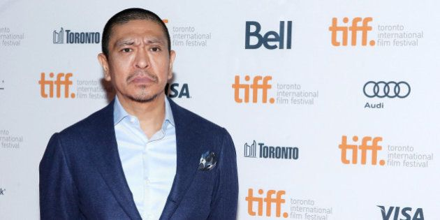TORONTO, ON - SEPTEMBER 12: Director Hitoshi Matsumoto attends the premiere of 'R100' at Ryerson Theatre...