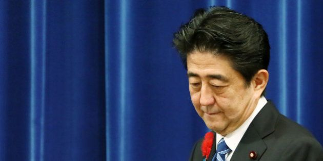 Shinzo Abe, Japan's prime minister, arrives for a news conference at the prime minister's official residence...