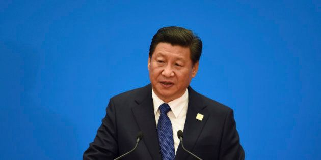 China's President Xi Jinping speaks during a press conference to close the Asia-Pacific Economic Cooperation...