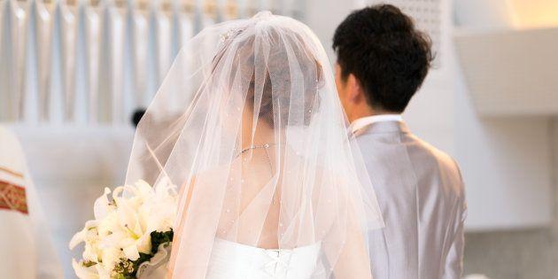 Happy bride and groom walking on virgin