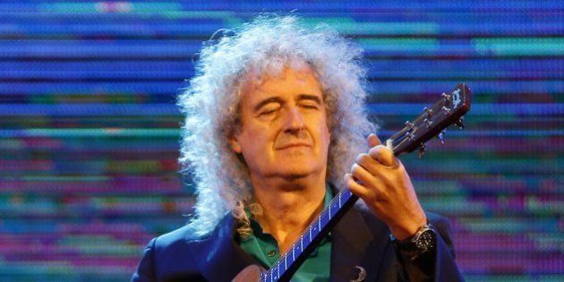 Brian May, guitarist of rock band Queen, performs with British singer Kerry Ellis (not pictured) during...